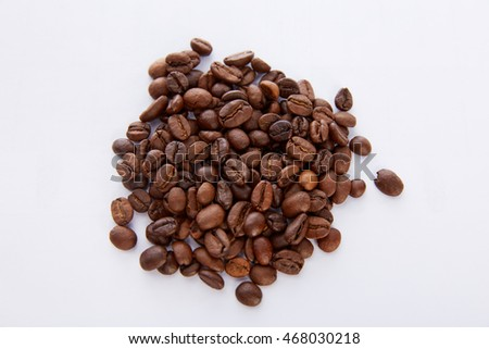 grain of black coffee on a light gray background