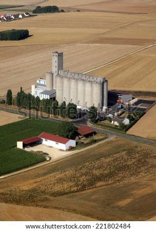 Grain silo in the wheat fields - stock photo