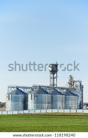 Grain silo storage for food processing cereal elevator tank - stock photo