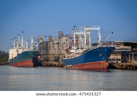 Grain silos and cargo ship at Port of of Bangkok, Thailand
