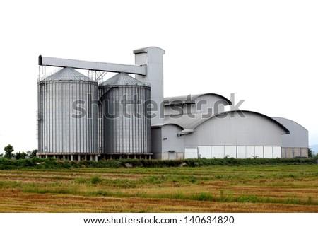 grain silos on a white background - stock photo
