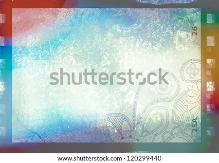 Grained film strip abstract grunge texture with paisley ornament and light effect - stock photo
