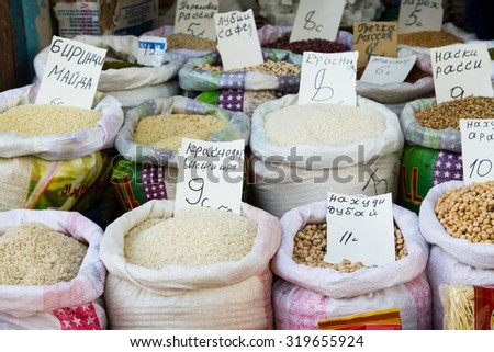 Grains and beans groceries in bulk bags at market, Khojant, Tajikistan, Central Asia - stock photo