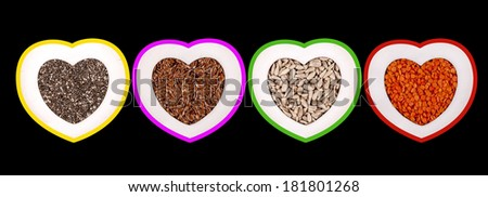 Grains and seeds collection (chia, flax, lentils, sunflower) in colorful heart shaped frames. - stock photo