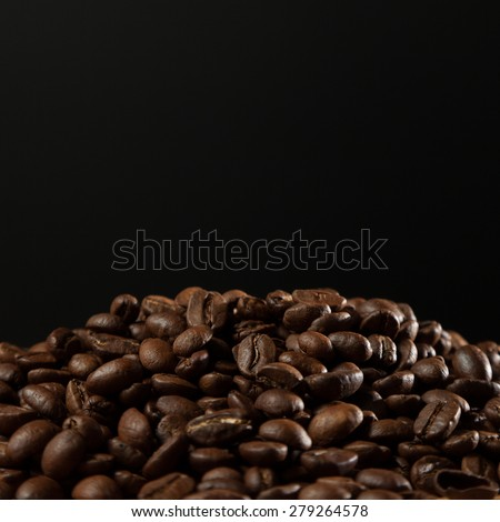 Grains of coffee on a black background - stock photo