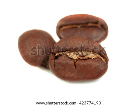 Grains of coffee on a white background, isolated.