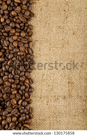 grains of coffee on rough woven - stock photo