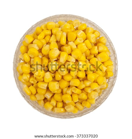 Grains of corn in a glass dish in isolation. Ripe corn isolated. Sweet whole kernel corn. - stock photo
