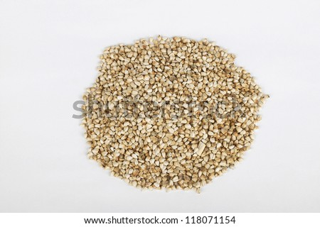 grains of herbal ingredients put together on white paper
