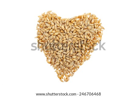 Grains of wheat in a heart shape isolated against white