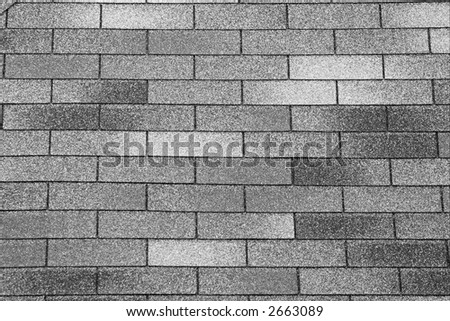 Grainy gray tiles on a roof