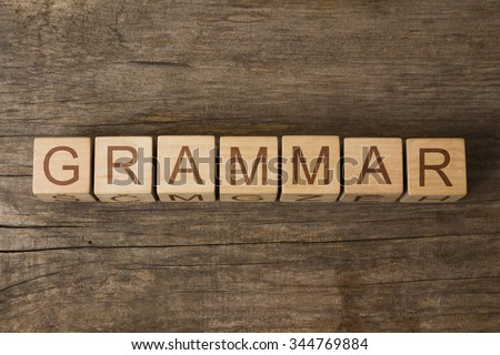 GRAMMAR text on a wooden background - stock photo