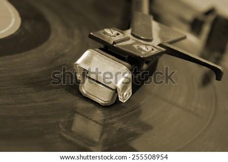 Gramophone needle closeup - stock photo