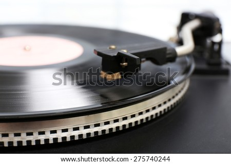 Gramophone with a vinyl record, closeup - stock photo
