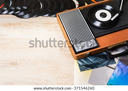 Gramophone with a vinyl record on wooden table, top view and copy space,photo. - stock photo