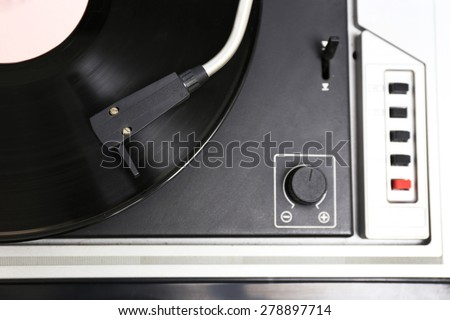 Gramophone with a vinyl record, top view - stock photo