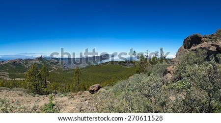 Gran Canaria, Caldera de Tejeda from Pico de Las Nieves, clouds flowing into the caldera on the right - stock photo
