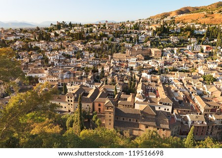 Granada, aerial panoramic view of old Albaicin district from Alhambra on sunset. Andalusia, Spain, Europe. - stock photo
