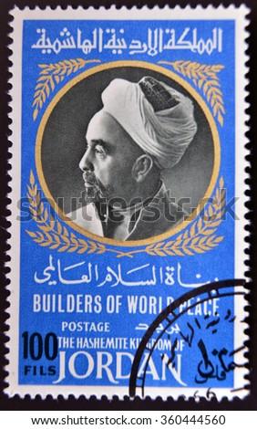 GRANADA, SPAIN - APRIL 14, 2014: A stamp printed in Jordan shows Portrait of King Abdullah I of Jordan (1882-1951), 1967 - stock photo
