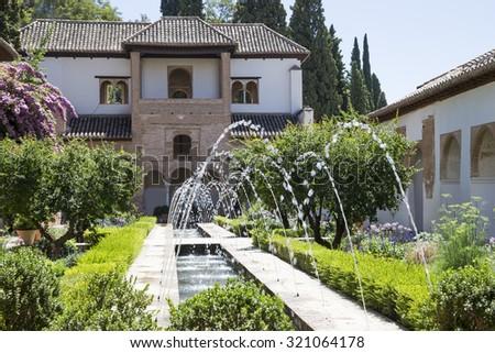 GRANADA, SPAIN- AUGUST 26, 2014:Alhambra Palace - medieval moorish castle in Granada, Andalusia, Spain   - stock photo
