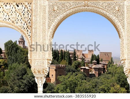 GRANADA, SPAIN- AUGUST 26, 2014:Arches in Islamic (Moorish)  style and  Alhambra, Granada, Spain - stock photo