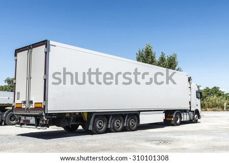 Granada, Spain - August 18, 2015: White truck equipped with refrigeration goods parked at a gas station