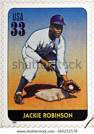 GRANADA, SPAIN - DECEMBER 1, 2015: A stamp printed in USA dedicated to Legends of Baseball shows Jackie Robinson, 2000 - stock photo