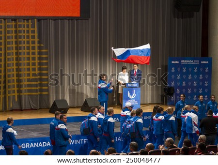 GRANADA, SPAIN - FEBRUARY 4, 2015: opening ceremony of the Winter Universiade 2015, Granada. Flag Bearer and Russian team during the ceremony