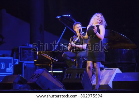 GRANADA, SPAIN - JULY 18, 2015: Eliane Elias, at 28 International Festival Jazz en la Costa, Almunecar, Spain. Marc Johnson, bass, Rubens De LaCorte, guitar, and Rafael Barata, drums.