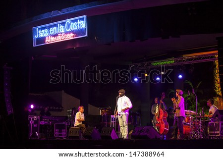 GRANADA, SPAIN - JULY 21: Gregory Porter, Chip Crawford (piano), Emanuel Harrold (drums), Aaron James (bass) and Yohsuke Satoh (saxo) at the XXVI Jazz Festival on July 20, 2013 in Almunecar, Spain
