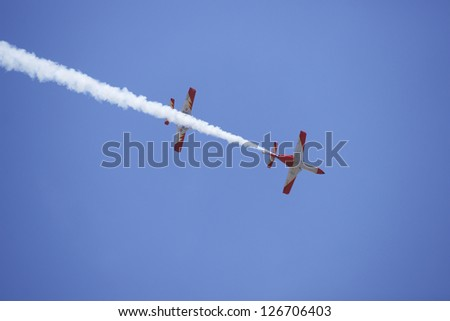 GRANADA,SPAIN - JUNE 19: Aerobatic Spanish patrol (Eagle Patrol) perform at an airshow (Open day of the airbase Armilla) on June 19, 2011 in Granada,Spain