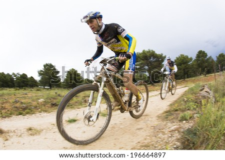 "GRANADA, SPAIN - JUNE 1: Unknowns racers on the competition of the mountain bike ""La Mamut Padul Bike"" on June 1, 2014 in Granada, Spain"