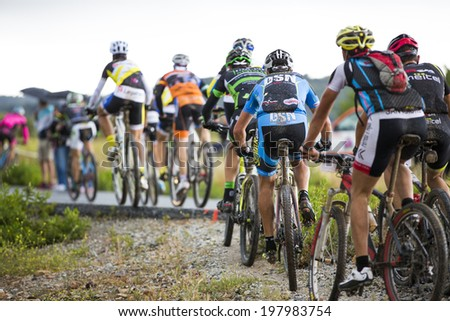 "GRANADA, SPAIN - JUNE 1: Unknowns racers on the competition of the mountain bike ""La Mamut Padul Bike"" on June 1, 2014 in Granada, Spain - stock photo"