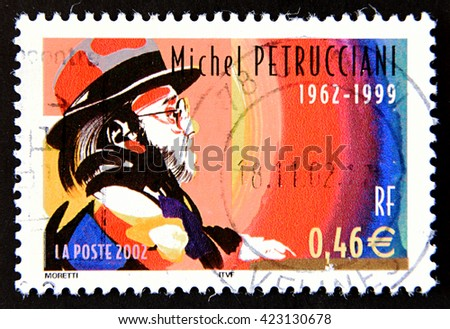 GRANADA, SPAIN - MAY 15, 2016: A stamp printed in France shows portrait of famous French jazz pianist Michel Petrucciani, 2002 - stock photo