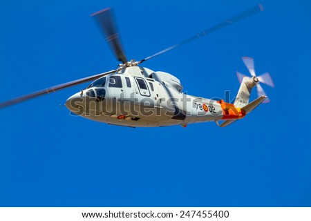 GRANADA, SPAIN-MAY 18:  Helicopter Sikorsky S-76C taking part in an exhibition on the X Aniversary of the Patrulla Aspa on the Airbase of Armilla on May 18, 2014, in Granada, Spain - stock photo