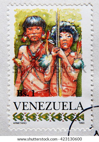 GRANADA, SPAIN - MAY 15, 2016: Stamp printed in Venezuela shows Two Yanomami Children, circa 1993