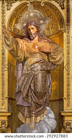GRANADA, SPAIN - MAY 29, 2015: The carved and polychrome statue of The Heard of Jesus  in church Real Colegiata de San Hipolito by Sanchez Castinez drom 19. cent.