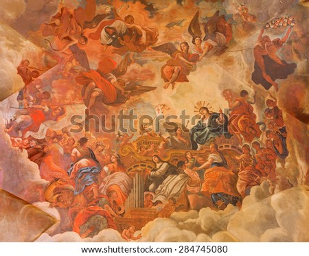 GRANADA, SPAIN - MAY 29, 2015: The ceiling fresco displays the Glory of lamb of God in Basilica San Juan de Dios by  Diego Sanchez Sarabia from second part of 18. cent.  - stock photo