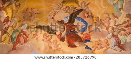 GRANADA, SPAIN - MAY 31, 2015: The detail of angles fresco in baroque sanctuary (Sancta Sanctorum) in church Monasterio de la Cartuja by Palomino (early of 18. cent.) - stock photo