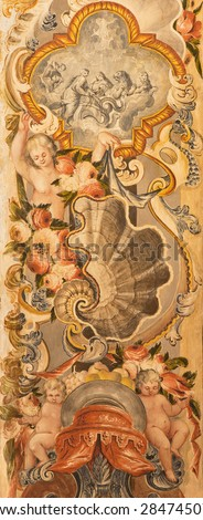 GRANADA, SPAIN - MAY 29, 2015: The symbolic baroque decoration fresco with the angels and flowers in Basilica San Juan de Dios by  Diego Sanchez Sarabia from second part of 18. cent.  - stock photo
