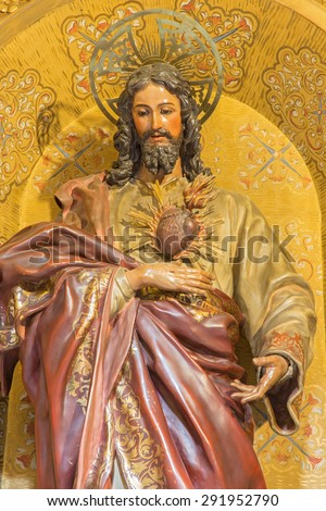 GRANADA, SPAIN - MAY 29, 2015: The the carved statue of The Heard of Jesus in church Nuestra Senora de las Angustias by Josr de Mora (17. cent.).