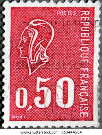 GRANADA, SPAIN - NOVEMBER 15, 2015:   A stamp printed in France shows woman's head in profile, circa 1970 - stock photo