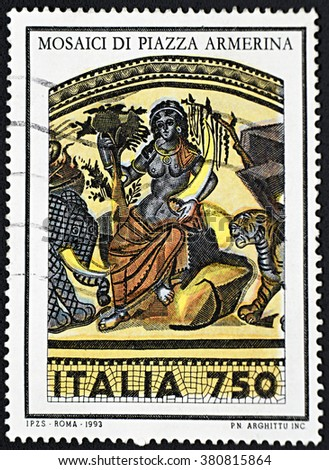 GRANADA, SPAIN - NOVEMBER 30, 2015: A stamp printed in Rome shows priestess surrounded by tiger and elephant, mosaics of Piazza Armerina, 1993 - stock photo