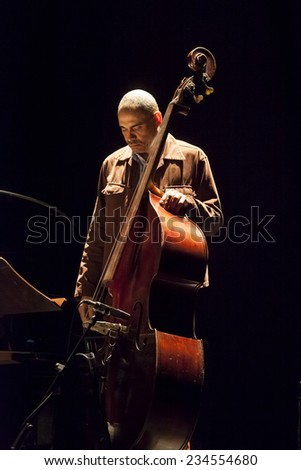 GRANADA / SPAIN - NOVEMBER 15, 2014: Ugona Ogkewo , bass, Tom Harrell and Trio Of Life, playing live music, at XXXV international jazz festival in Granada.