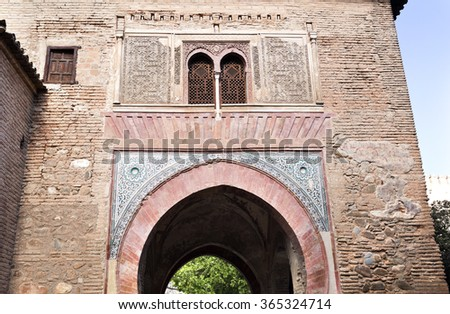 GRANADA, SPAIN - SEPTEMBER 8 2015: Detail of the mudejar architecture at the Wine Gate in The Alhambra, on September 8, 2015, in Granada, Spain - stock photo