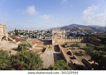 GRANADA, SPAIN - SEPTEMBER 8 2015:  The Homage and Hens Towers with a view of the Albaicin district in the background, in The Alhambra, on September 8, 2015, in Granada, Spain - stock photo