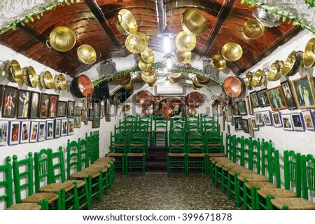 GRANADA, SPAIN - SEPTEMBER 30, 2015:The interior of a cave house in the neighborhood of the Sacromonte in Granada - Spain. Flamengo dancers perform there daily.