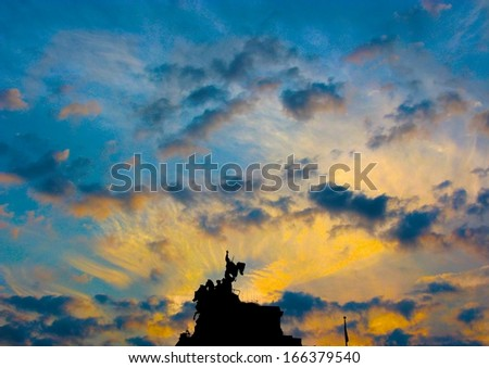 Grand Army Plaza statues in silhouette at sunset, Brooklyn, NYC - stock photo