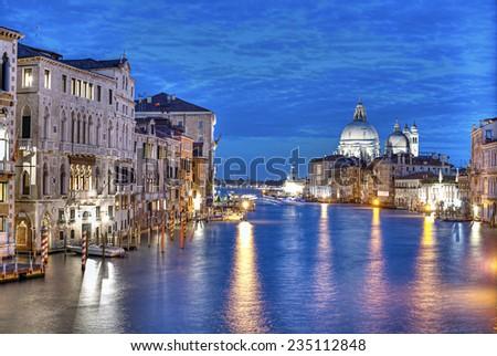 Grand Canal and Basilica Santa Maria della Salute at evening after sunset, Venice (Venezia), Italy, Europe - stock photo