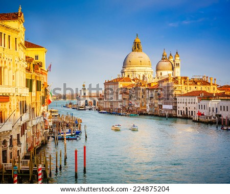 Grand Canal and Basilica Santa Maria della Salute in Venice - stock photo